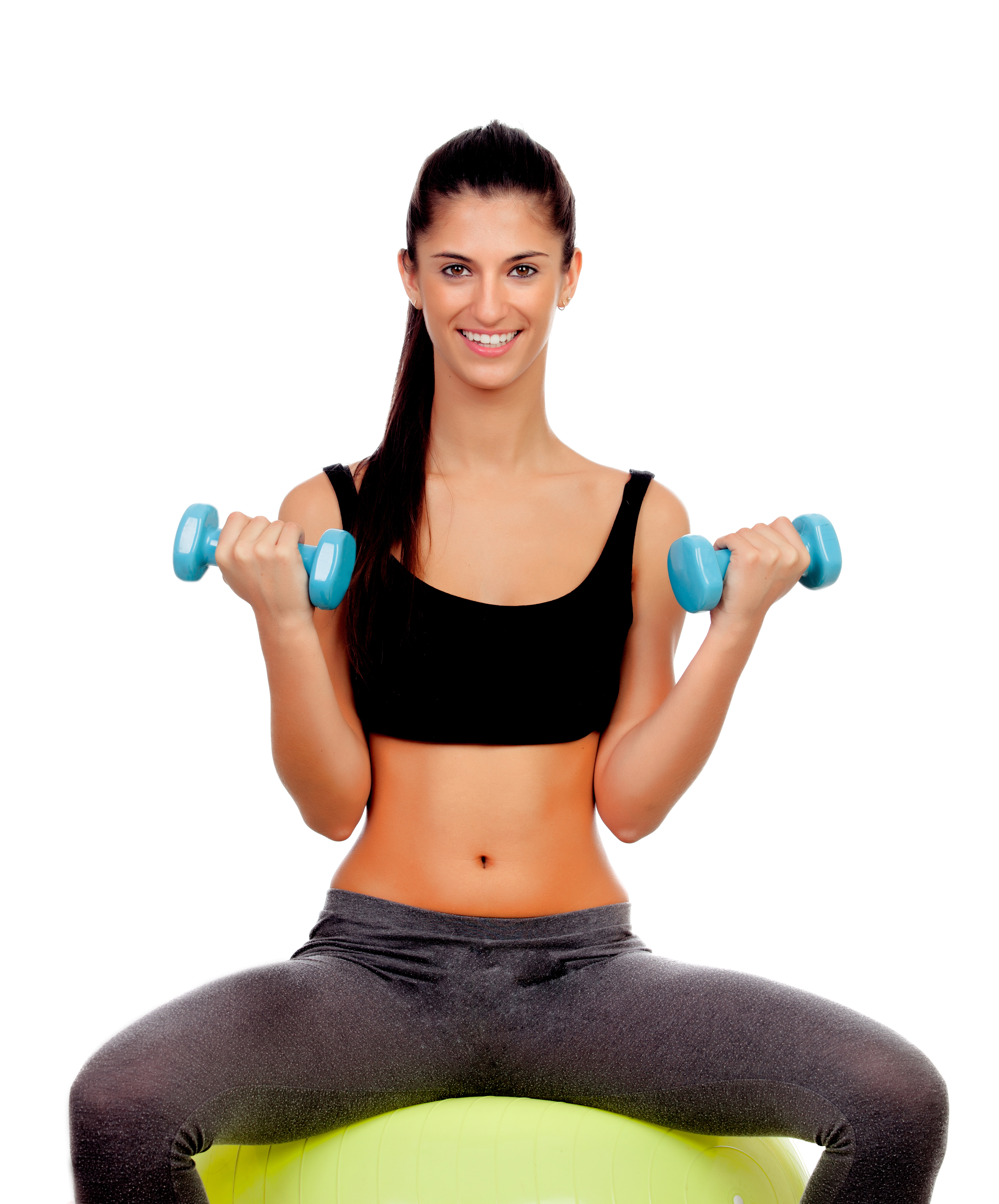 Attractive girl lifting weights sitting on a ball